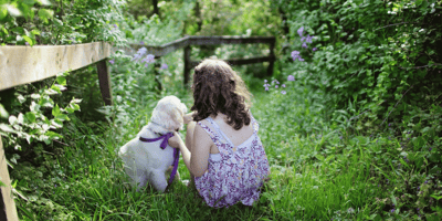 Little girl and puppy outside