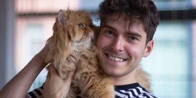 Matt Weatherall holding ginger cat