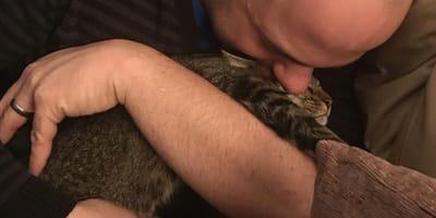 Tadeu Vaccari hugs Bruce the cat
