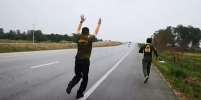 Paramedics rush into the middle of the road to save a tiny kitten