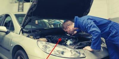 Mechanics disassembling a car engine