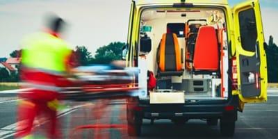 Paramedics putting man in their van