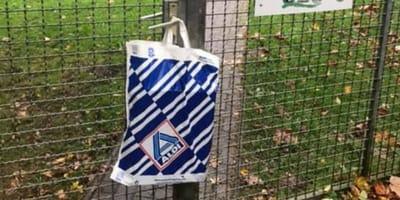 Aldi bag hanging on a fence