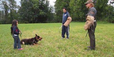 bambina-cane-e-due-uomini-nel-parco