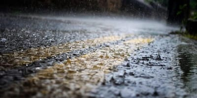 Rain falls onto a British road