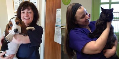 Vet staff holding cat and dog