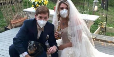 Couple tie the knot with dogs as bridesmaids after wedding cancelled