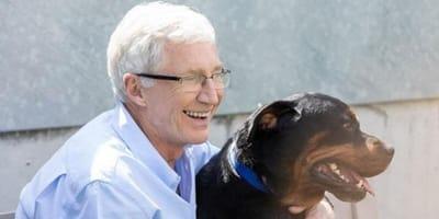 Paul O'Grady sits with Rottweiler