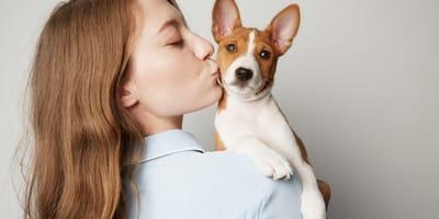 Owner kissing her dog