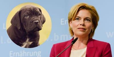Julia Klöckner und ein schwarzer Welpe