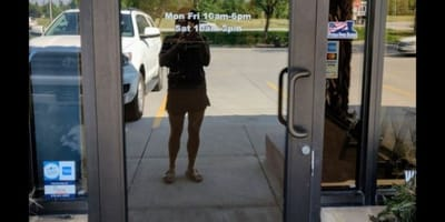 When a dog lover reads the sign on a shop door, she can't resist going inside