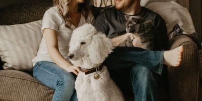 Couple with cat and dog