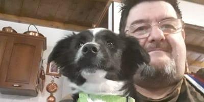 cane-con-uomo-collare-verde