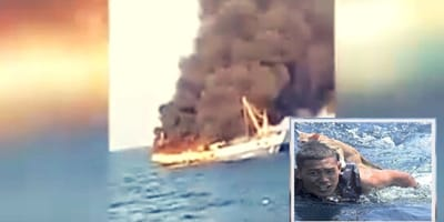 barca-in-fiamme-e-salvataggio-di-gatti.jpg