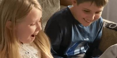Children surprised with tabby kitten