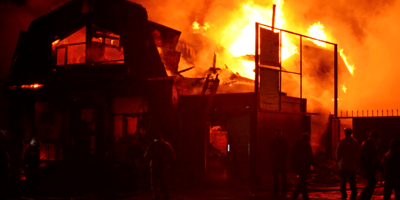 When firefighters realise which shop is burning, they rush in without hesitation