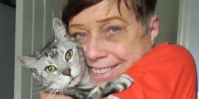 Owner cuddling cat