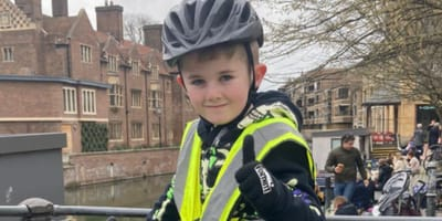 A boy raises money for dog charity by cycling
