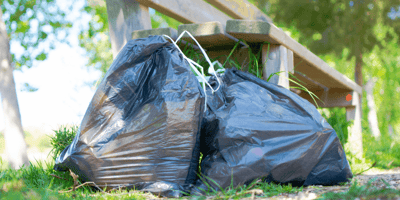 two-bin-bags-next-to-park-bench