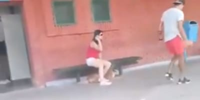 Woman with her dog at a train station starts running as the train closes, the world is outraged