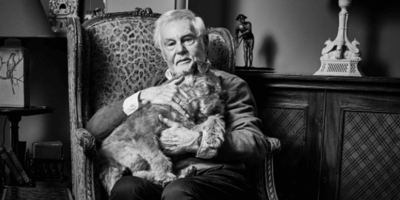 Sir Derek Jacobi poses for portrait with his dog for the best reason